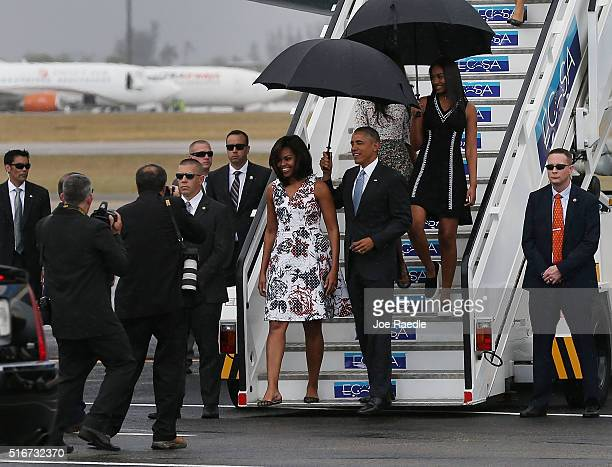 President Barack Obama Michelle Obama and Sasha Obama walk down the stairs as they arrive at Jose Marti International Airport on Airforce One for a...