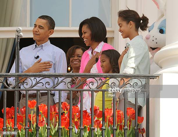 US President Barack Obama Michelle's mother Marian Robinson First Lady Michelle Obama and their daughters Sasha and Malia listen to the National...