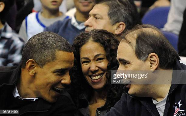US President Barack Obama Mona Sutphen White House Deputy Chief of Staff for Policy and Senior Advisor David Axelrod attend the game between the Duke...