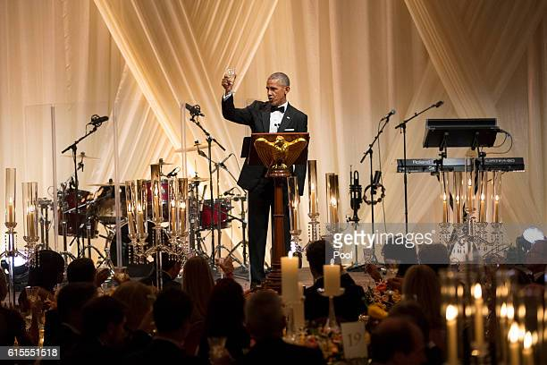 President Barack Obama offers a toast to Italian Prime Minister Matteo Renzi at a state dinner on the South Lawn of the White House October 18, 2016...