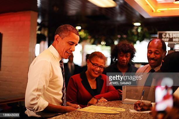 US President Barack Obama orders food at the Roscoe's Chicken and Waffles in Los Angeles California on October 24 2011 Obama said the vast majority...
