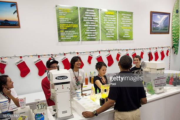 US President Barack Obama orders shave ice at Island Snow at Kailua Beach Center on December 27 2010 in Kailua Hawaii The Obamas visited troops at a...