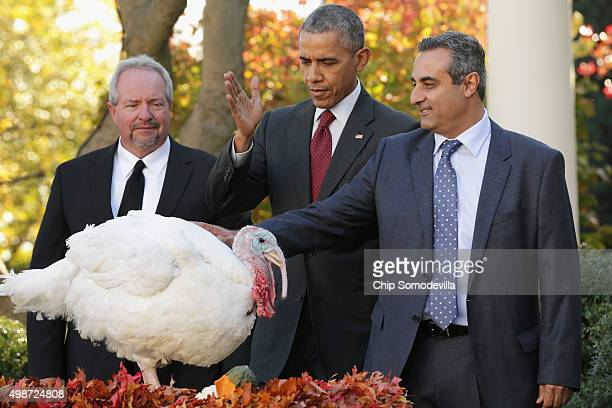 S President Barack Obama pardons Abe a 42pound male turkey during a ceremony with National Turkey Federation Chairman Jihad Douglas and turkey farmer...