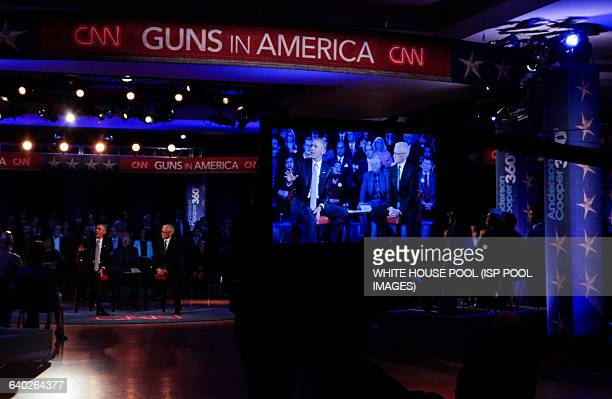 US President Barack Obama participates in a live town hall event with CNN's Anderson Cooper on reducing gun violence in America at George Mason...