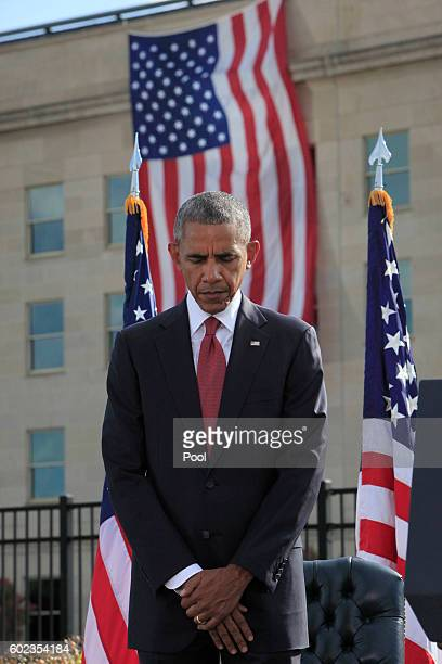 S President Barack Obama participates in a moment of silence during a ceremony to mark the 15th anniversary of the 9/11 terrorists attacks at the...