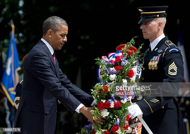 US President Barack Obama participates in a wreathlaying ceremony at the Tomb of the Unknown Soldier in honor of Memorial Day at Arlington National...