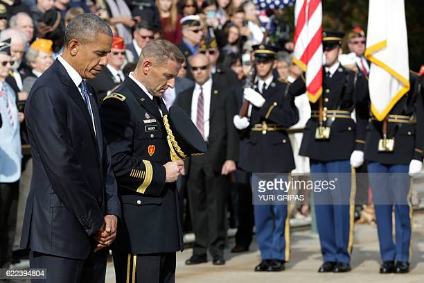 US President Barack Obama participates in a wreathlaying ceremony at the Tomb of the Unknown Soldier at Arlington National Cemetery in Arlington...