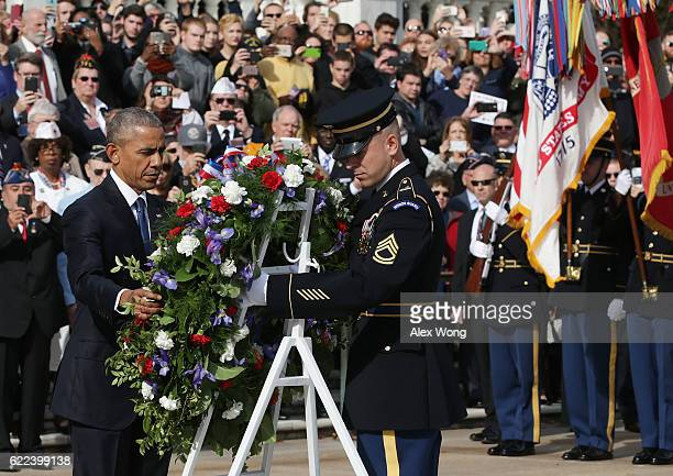 S President Barack Obama participates in a wreathlaying ceremony at the Tomb of the Unknown Soldier at Arlington National Cemetery on Veterans Day...