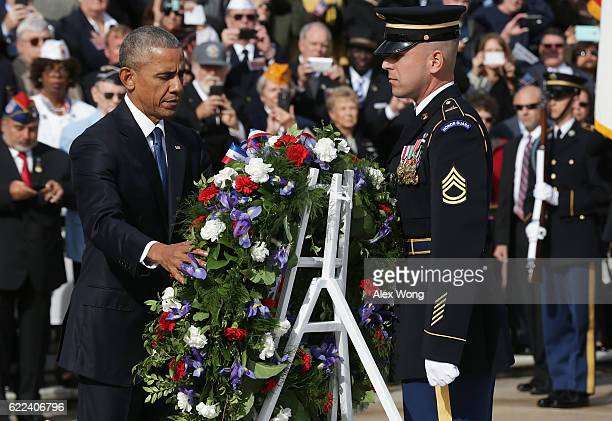 President Barack Obama participates in a wreath-laying ceremony at the Tomb of the Unknown Soldier at Arlington National Cemetery on Veterans Day...