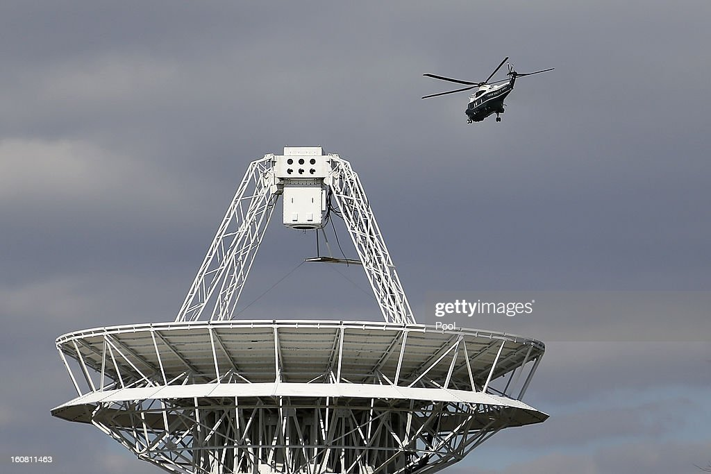 U.S. President Barack Obama passes near a satellite dish as he departs via Marine One helicopter from a landing zone at the U.S. Naval Academy February 6, 2013 in Annapolis, Maryland. Obama attended the Senate Democratic Issues Conference at a nearby hotel.