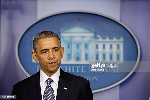 S President Barack Obama pauses as he announces the resignation of Secretary of Veterans Affairs Eric Shinseki in the briefing room of the White...