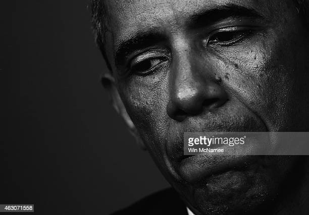 President Barack Obama pauses as he answers a question about violence in the wake of the shooting of Michael Brown in Ferguson, Missouri during a...