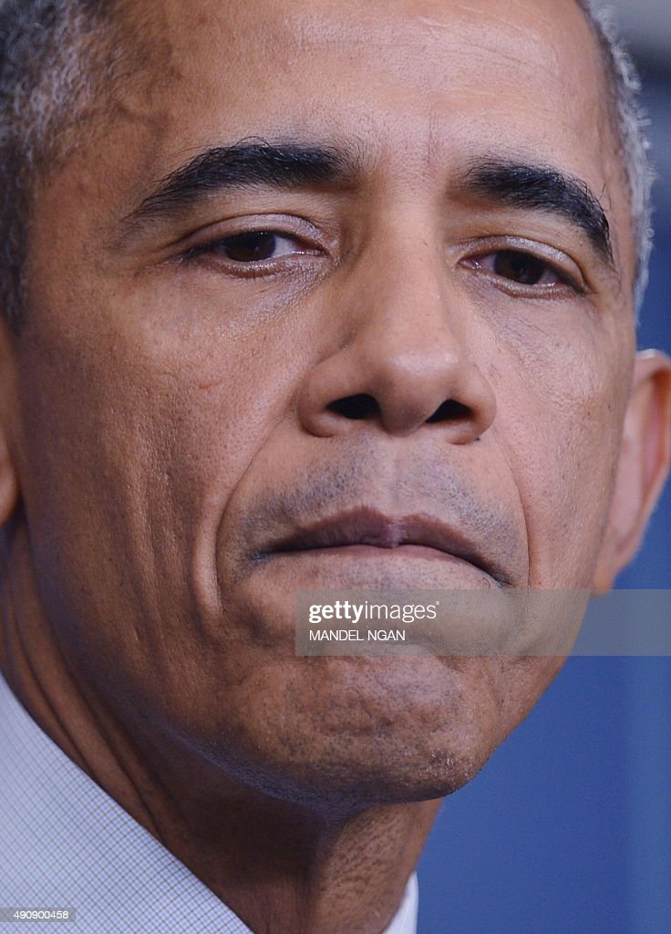 US President Barack Obama pauses as he delivers a statement, after a shooting at a community college in Oregon that left up to 10 people dead, in the Brady Briefing Room of the White House in Washington, DC on October 1, 2015. A 20-year-old gunman opened fire inside a classroom at Umpqua Community College in rural Roseburg, before being 'neutralized' by police, authorities said. He was later confirmed dead.