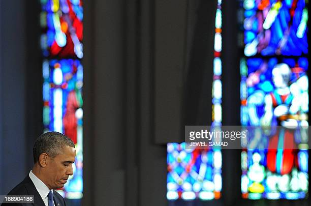 US President Barack Obama pauses as he speaks during Healing Our City An Interfaith Service dedicated to those who were gravely wounded or killed in...