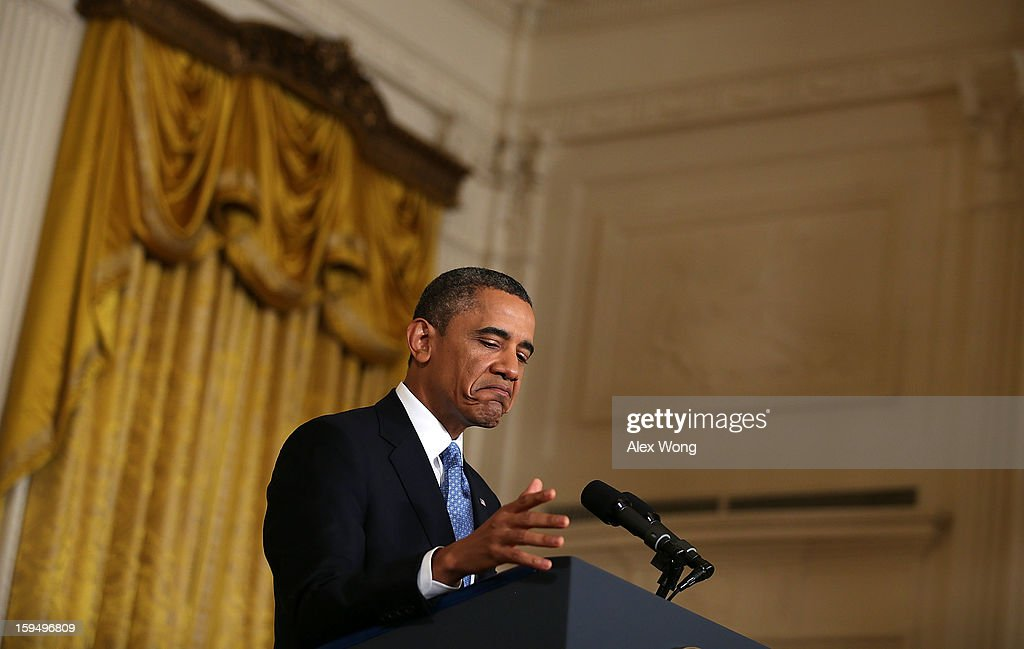 U.S. President Barack Obama pauses as he speaks during his final news conference of his first term at the East Room of the White House January 14, 2013 in Washington, DC. Obama spoke on the debt ceiling and deficit reduction during the news conference.