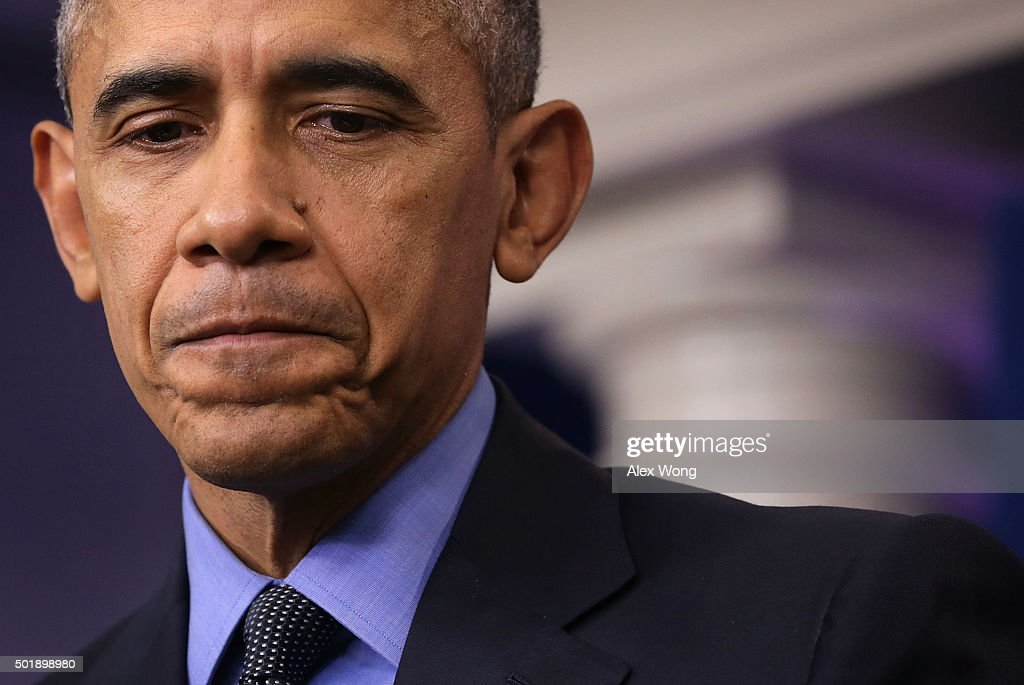 U.S. President Barack Obama pauses as he speaks to the media during his year end press conference in the Brady Briefing Room at the White House December 18, 2015 in Washington, DC. Later today President Obama will travel to San Bernardino, California, to meet with families of the 14 victims of the recent mass shooting, before heading to Hawaii for Christmas vacation and return on January 3, 2016.