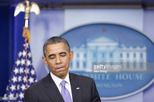 S President Barack Obama pauses during a news conference at the James Brady Press Briefing Room of the White House December 20 2013 in Washington DC...