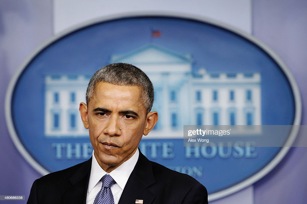 U.S. President Barack Obama pauses during his speech to members of the media during his last news conference of the year in the James Brady Press Briefing Room of the White House December 19, 2014 in Washington, DC. President Obama faced questions on various topics including the changing of Cuba policy, the U.S. economy and the Sony hack.