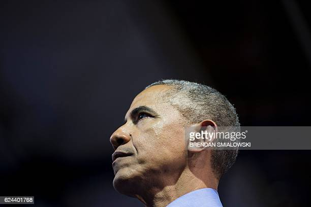 US President Barack Obama pauses while speaking during a Young Leaders of the Americas Initiative town hall meeting at the Pontifical Catholic...