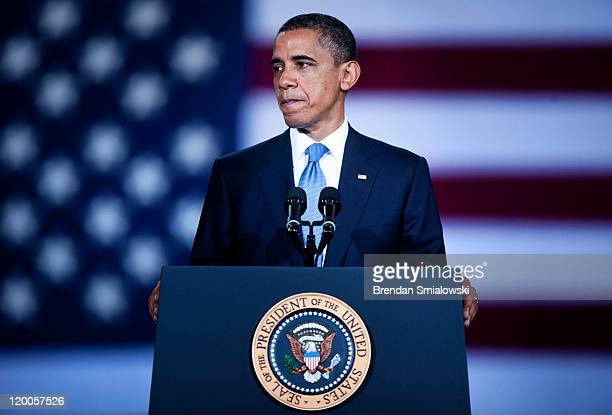 S President Barack Obama pauses while speaking during an event announcing new auto fuel economy standards at the Washington Convention Center July 29...