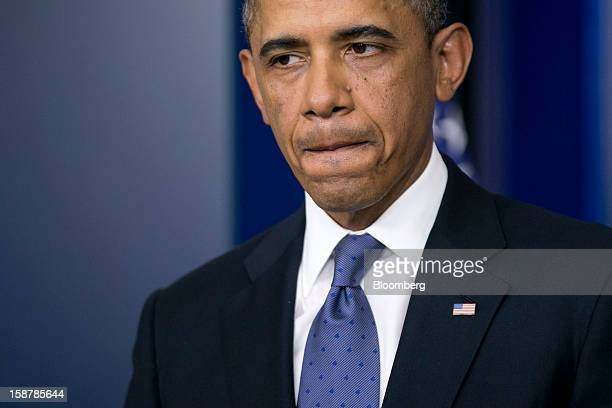 US President Barack Obama pauses while speaking in the Brady Press Briefing Room at the White House in Washington DC US on Friday Dec 28 2012 Obama...