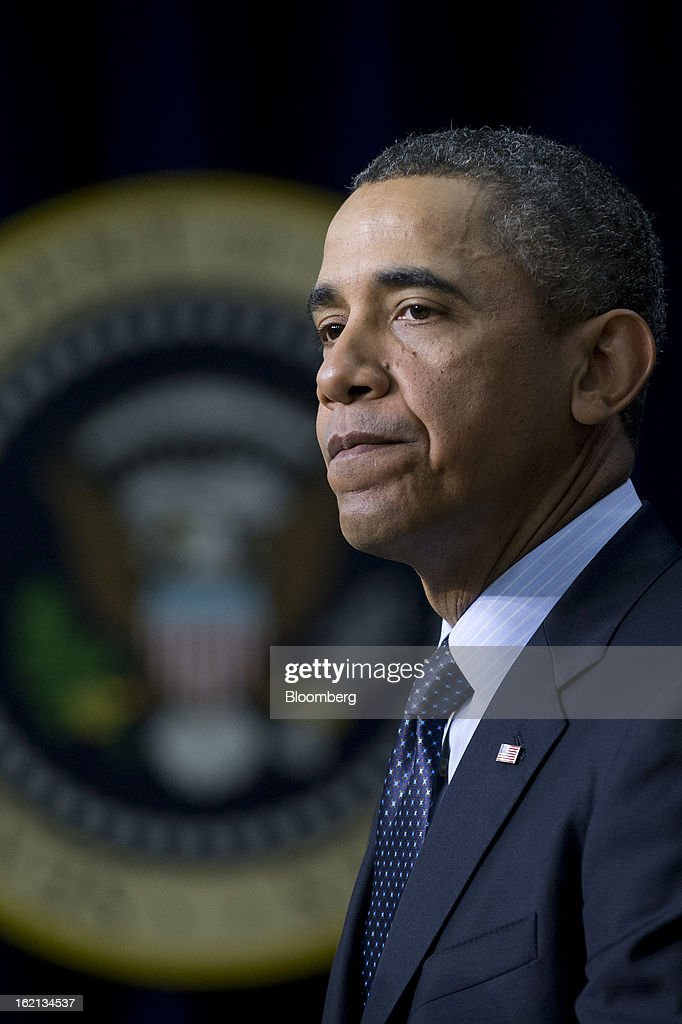 U.S. President Barack Obama pauses while speaking in the South Court Auditorium of the Eisenhower Executive Building next to the White House in Washington, D.C., U.S., on Tuesday, Feb. 19, 2013. Obama stepped up pressure on Congress to avert 'brutal' automatic $1.2 trillion in budget cuts set to kick in March 1, saying it would harm the economy and curtail vital services. Photographer: Andrew Harrer/Bloomberg via Getty Images