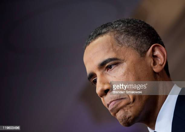 President Barack Obama pauses while speaking to the press in the briefing room of the White House July 22 2011 in Washington DC Obama spoke about the...