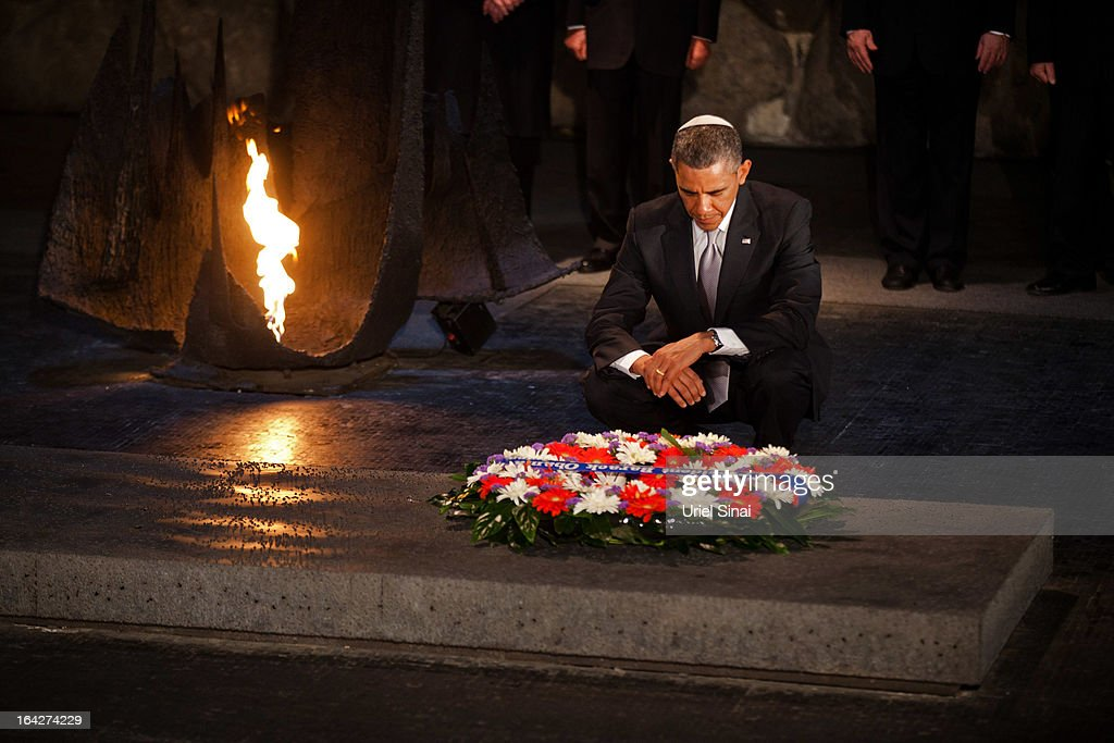 U.S. President Barack Obama pays his respects in the Hall of Remembrance in front of Israel's President Shimon Peres, Israel's Prime Minster Benjamin Netanyahu, Chairman of the Yad Vashem Directorate Avner Shalev and Rabbi Yisrael Meir Lau after marines layed a wreath on his behalf during his visit to the Yad Vashem on March 22, 2013 in Jerusalem, Israel. This is Obama's first visit as president to the region and his itinerary includes meetings with the Palestinian and Israeli leaders as well as a visit to the Church of the Nativity in Bethlehem.