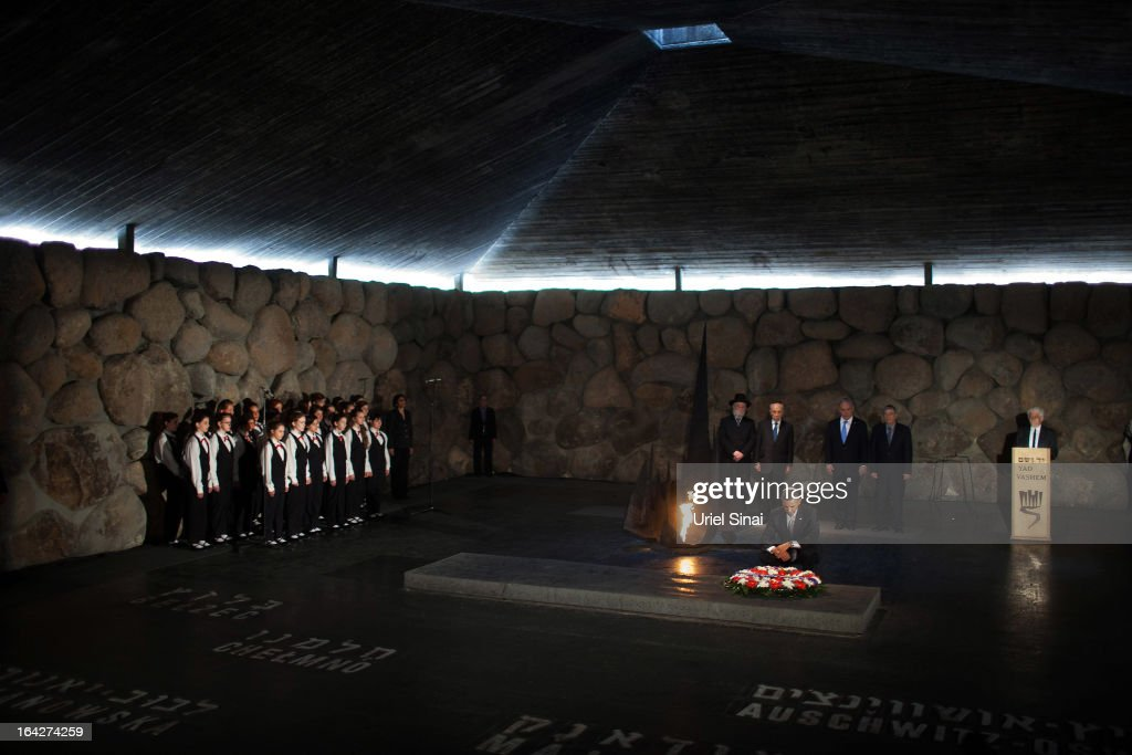U.S. President Barack Obama pays his respects in the Hall of Remembrance in front of Israel's President Shimon Peres, Israel's Prime Minster Benjamin Netanyahu, Chairman of the Yad Vashem Directorate Avner Shalev, Rabbi Yisrael Meir Lau and the Abnkor Children's Choir after marines layed a wreath on his behalf during his visit to the Yad Vashem on March 22, 2013 in Jerusalem, Israel. This is Obama's first visit as president to the region and his itinerary includes meetings with the Palestinian and Israeli leaders as well as a visit to the Church of the Nativity in Bethlehem.