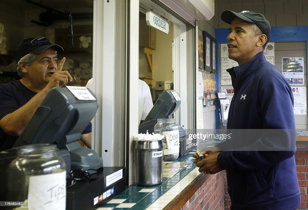 U.S. President Barack Obama Places an order at Nancy's Restaurant August 13, 2013 in Oak Bluffs, Massachusetts. President Obama and his family are spending the week on the island for their summer vacation.