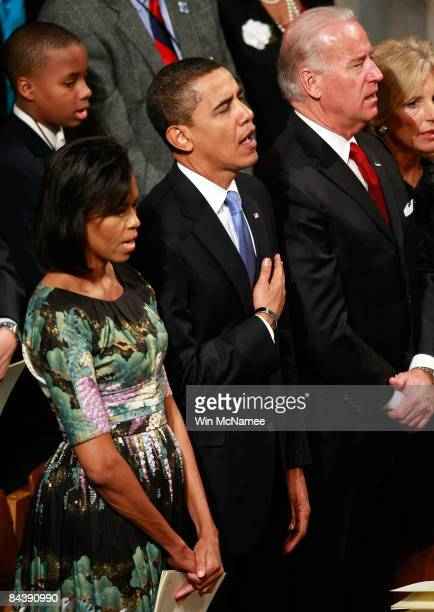 S President Barack Obama places his hand ove his heart while singing the National Anthem during the National Prayer Service at the Washington...