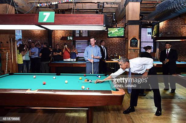 US President Barack Obama plays a game of pool with Colorado Governor John Hickenlooper at a local pub in Denver Colorado on July 8 2014 AFP...