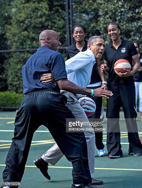 US President Barack Obama plays basketball with former NBA player Bruce Bowen during the annual Easter Egg Roll on the South Lawn of the White House...