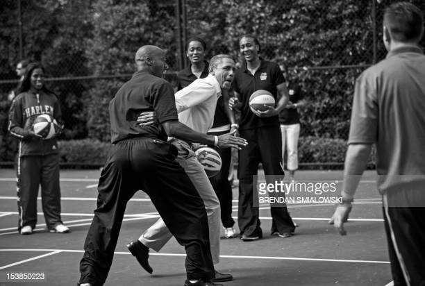 President Barack Obama plays basketball with former NBA player Bruce Bowen during the annual Easter Egg Roll on the South Lawn of the White House...