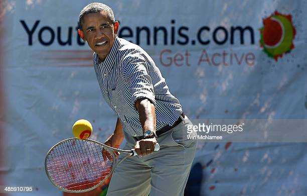 S President Barack Obama plays tennis as he participates in the annual White House Easter Egg Roll on the South Lawn April 21 2014 in Washington DC...