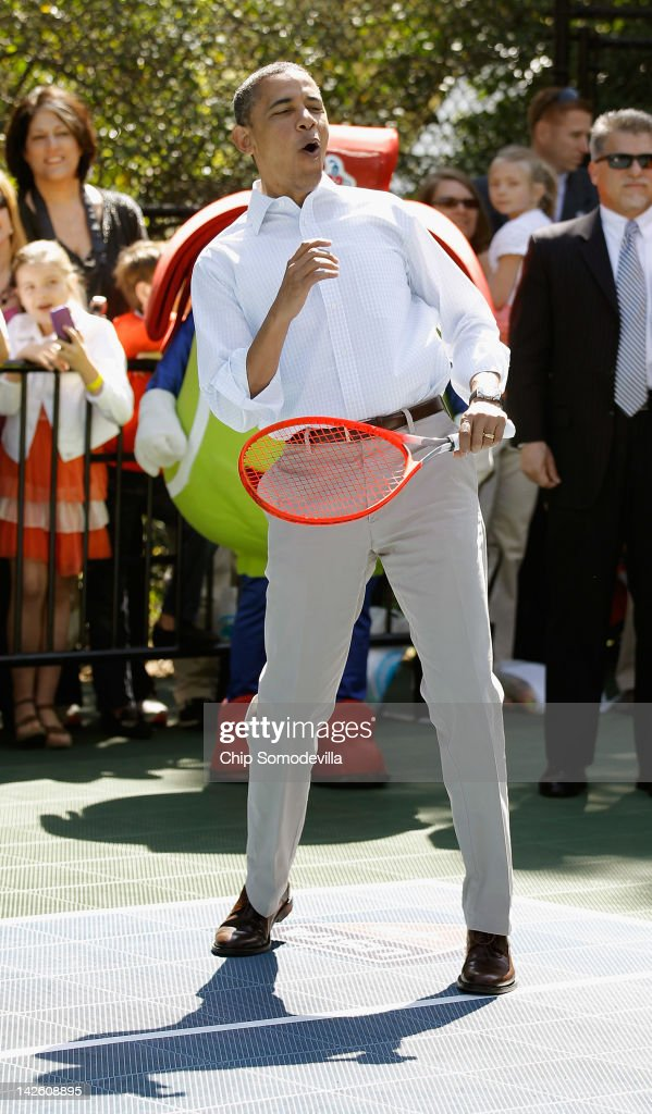 U.S. President Barack Obama plays tennis during the annual Easter Egg Roll on the White House tennis court April 9, 2012 in Washington, DC. Thousands of people people are expected to attend the 134-year-old tradition of rolling colored eggs down the White House lawn that was started by President Rutherford B. Hayes in 1878.