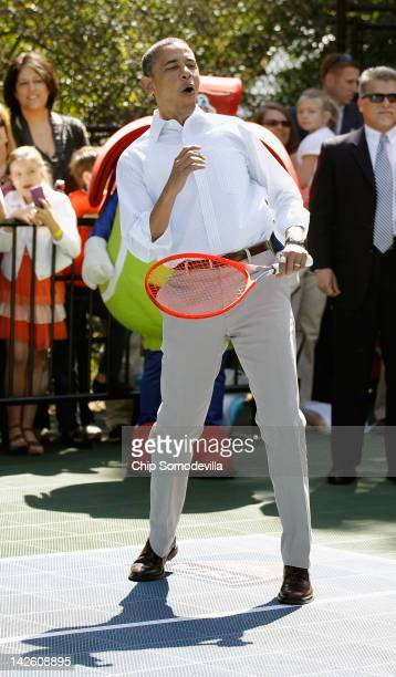 S President Barack Obama plays tennis during the annual Easter Egg Roll on the White House tennis court April 9 2012 in Washington DC Thousands of...