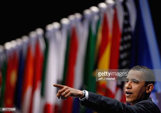 President Barack Obama points as he gives a briefing to reporters at the end of the G20 summit on April 2, 2009 in London. Earlier British Prime...