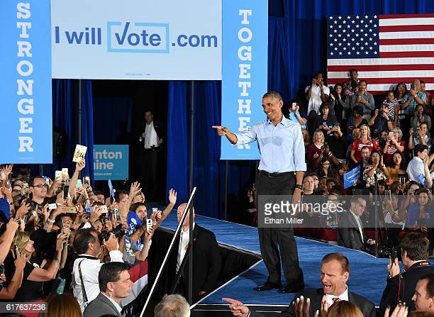 S President Barack Obama points at supporters after speaking at a campaign rally for Democratic presidential nominee Hillary Clinton at Cheyenne High...