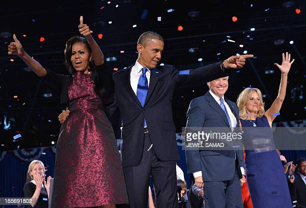 US President Barack Obama points at supporters as First Lady Michelle Obama gives the thumbsup flanked by VicePresident Joe Biden and Second Lady...
