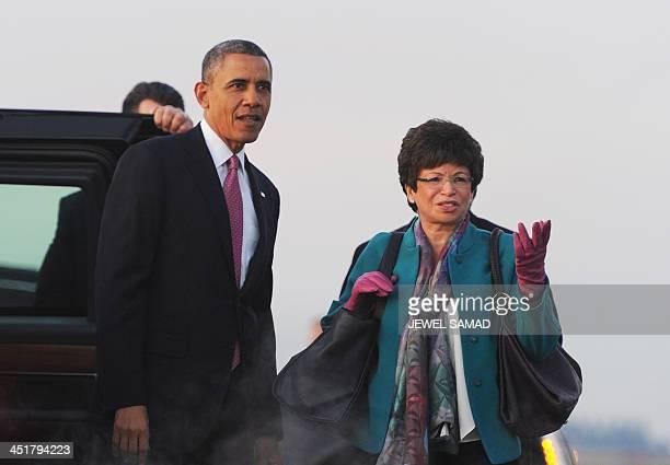 US President Barack Obama points to Mount Rainier to his senior adviser Valerie Jarrett upon arriving at SeattleTacoma International Airport in...