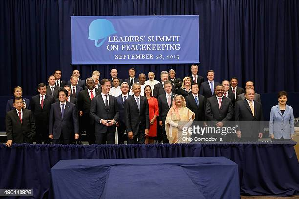 US President Barack Obama poses for a 'class photograph' with the Leaders' Summit on Peacekeeping participants during the 70th annual UN General...