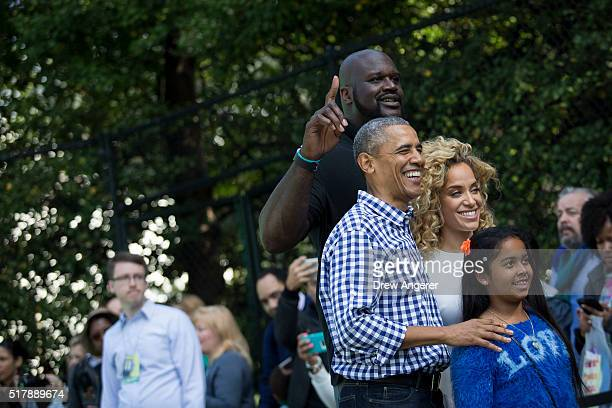 President Barack Obama poses for a photo with former NBA player Shaquille O'Neal and reality television personality Nicole Hoopz Alexander on the...