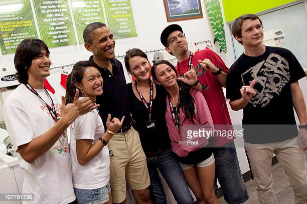 US President Barack Obama poses for a portrait with store staff at Island Snow at Kailua Beach Center on December 27 2010 in Kailua Hawaii The Obamas...