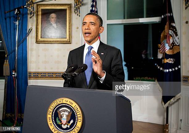 S President Barack Obama poses for photographers after reading a statement about a budget agreement to keep the US goverment funded at the White...