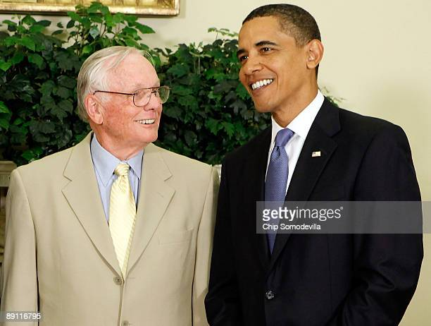 S President Barack Obama poses for photographs with Apollo 11 astronaut Neil Armstrong the first man on the moon in the Oval Office at the White...