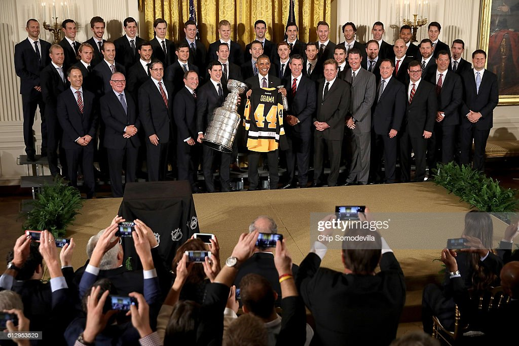 U.S. President Barack Obama poses for photographs with the National Hockey League champion Pittsburgh Penguins while celebrating their Stanley Cup victory in the East Room of the White House October 6, 2016 in Washington, DC. The Penguins defeated the San Jose Sharks in six games in the 2016 NHL Finals, the fourth time the franchise has won the Stanley Cup.