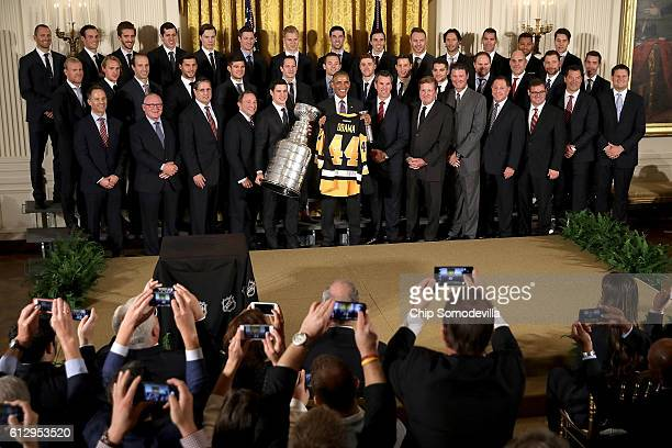 S President Barack Obama poses for photographs with the National Hockey League champion Pittsburgh Penguins while celebrating their Stanley Cup...
