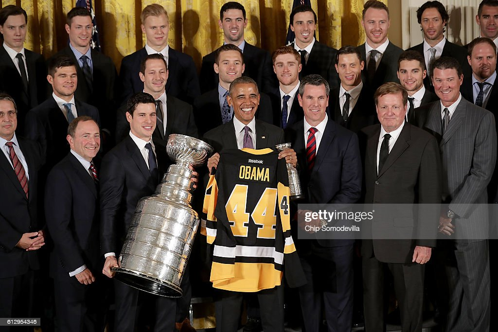U.S. President Barack Obama poses for photographs with the National Hockey League champion Pittsburgh Penguins, including Coach Mike Sullivan, owners Ronald Burkle and Mario Lemieux and NHL Commissioner Gary Bettman while celebrating the team's Stanley Cup victory in the East Room of the White House October 6, 2016 in Washington, DC. The Penguins defeated the San Jose Sharks in six games in the 2016 NHL Finals, the fourth time the franchise has won the Stanley Cup.