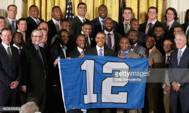 S President Barack Obama poses for photographs with the players coaches and executives of the Super Bowl XLVIII champion Seattle Seahawks and their...